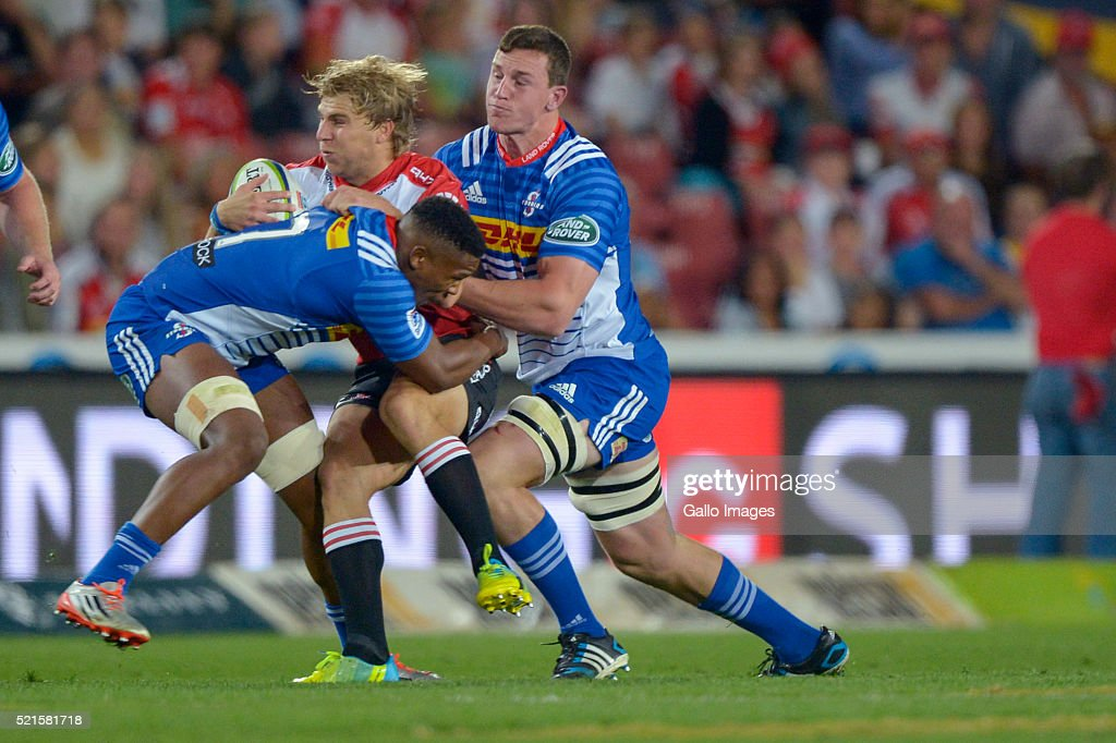 Jaco Van Der Walt of the Lions tacked by Sikhumbuzo Notshe and JD Schickerling of the Stormers during the 2016 Super Rugby match between Emirates Lions and DHL Stormers at Emirates Airline Park on April 16, 2016 in Johannesburg, South Africa.