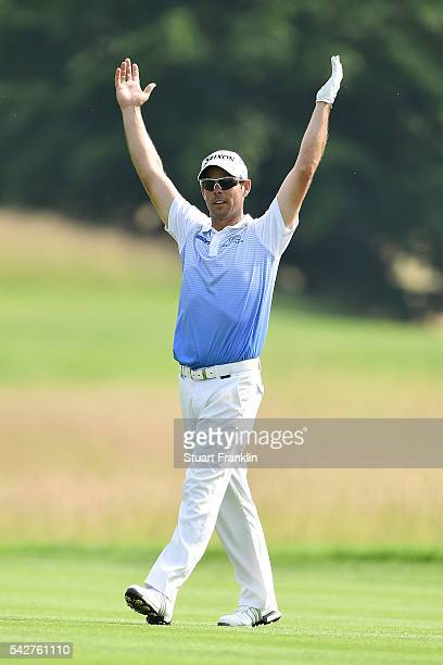 Jaco van Zyl of South Africa celebrates holing out for an eagle on the 12th hole during the second round of the BMW International Open at Gut...