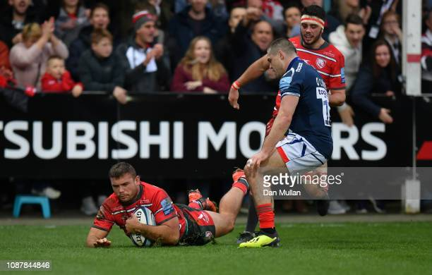 Jaco Visagie of Gloucester dives over to score his side's first try during the Gallagher Premiership Rugby match between Gloucester Rugby and Sale...