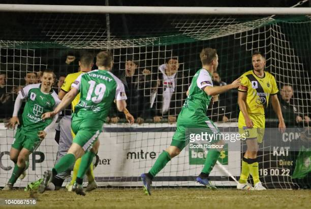 Jacob Alexander of Bentleigh Greens is congratulated by his teammates after scoring the first goal during the FFA Cup quarterfinal match between...