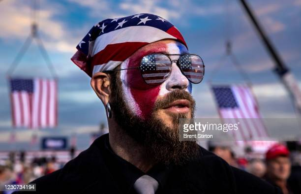 Jacob Anthony Angeli Chansley, known as the QAnon Shaman, is seen at a Trump rally in Dalton, Georgia on the 4th of January. He attended the Capitol...