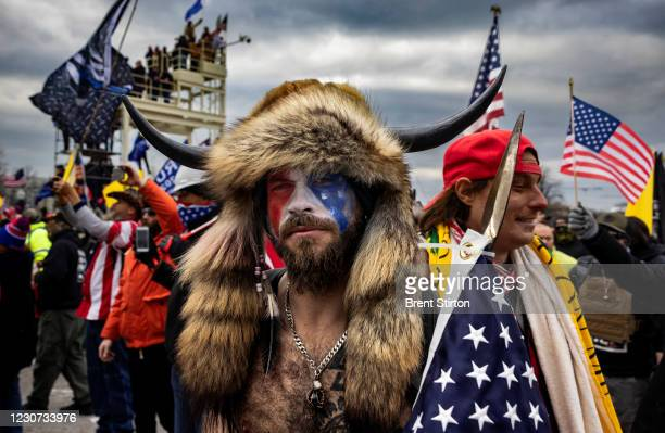 Jacob Anthony Angeli Chansley, known as the QAnon Shaman, is seen at the Capital riots. On January 9, Chansley was arrested on federal charges of...