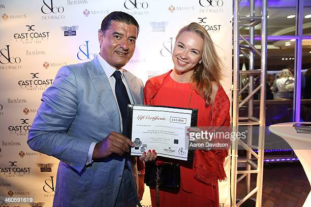 Jacob Arabo and Angelika Timanina attend Haute Time Russia Hosts Jacob Co And ECJ Holiday Party at Sunny Isles Beach Gallery on January 3 2014 in...