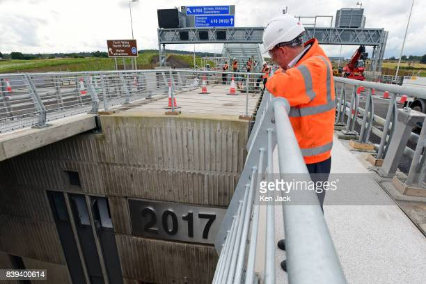 Jacob Arup Joint Venture Senior Site Engineer John Redpath looks down at the embossed completion date on the new Queensferry Crossing Road Bridge...