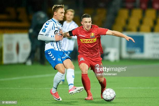 Jacob Barrett Laursen of OB Odense and Karlo Bartolec of FC Nordsjalland compete for the ball during the Danish Alka Superliga match between FC...