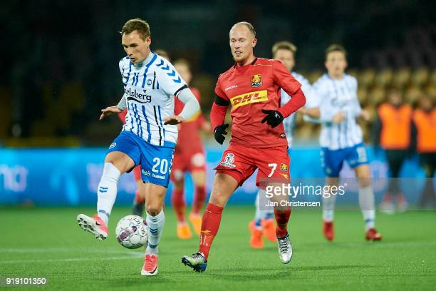 Jacob Barrett Laursen of OB Odense and Mikkel Rygaard of FC Nordsjalland compete for the ball during the Danish Alka Superliga match between FC...
