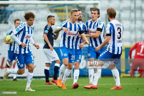 Jacob Barrett Laursen of OB Odense and teammates celebrating after his 12 goal during the Danish Superliga match between OB Odense and AGF Arhus at...