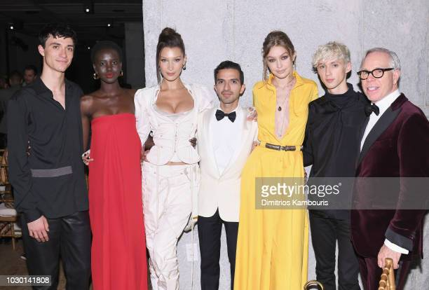 Jacob Bixenman Bella Hadid Adut Akech Founder EditorinChief of The Business of Fashion Imran Amed Gigi Hadid Troye Sivan and Tommy Hilfiger attend...
