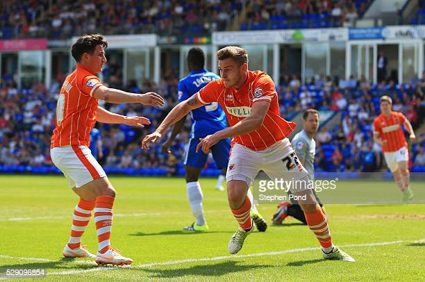 Jacob Blyth of Blackpool celebrates with Jack Redshaw as he scores their first goal with a header during the Sky Bet League One match between...