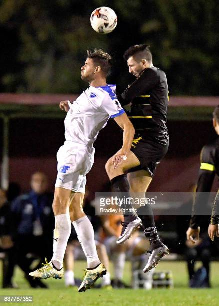 Jacob Boutoubia of Gold Coast City and Matthew Byrne of Moreton Bay compete for the ball during the FFA Cup round of 16 match between Moreton Bay...