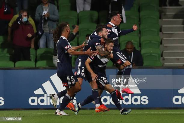 Jacob Brimmer of the Victory celebrates his penalty with teammates during the A-League match between the Melbourne Victory and the Perth Glory at...