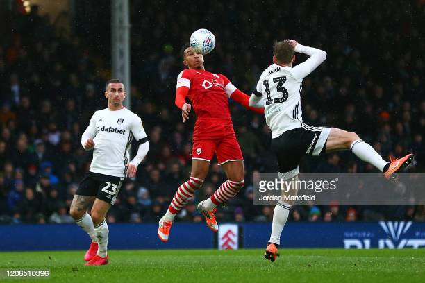 Jacob Brown of Barnsley controls the ball under pressure from Tim Ream and Joe Bryan of Fulham during the Sky Bet Championship match between Fulham...