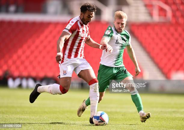 Jacob Brown of Stoke City battles for possession with Billy Mitchell of Millwall FC during the Sky Bet Championship match between Stoke City and...