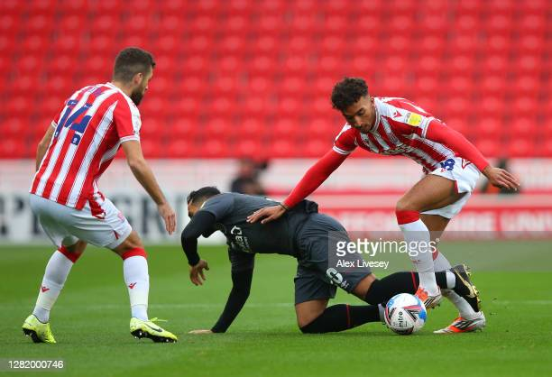 Jacob Brown of Stoke City battles for possession with Saman Ghoddos of Brentford during the Sky Bet Championship match between Stoke City and...