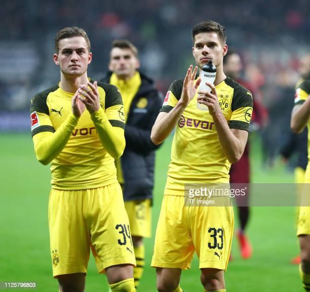 Jacob Bruun Larsen of Borussia Dortmund and Julian Weigl of Borussia Dortmund acknowlege the fans after the Bundesliga match between Eintracht...
