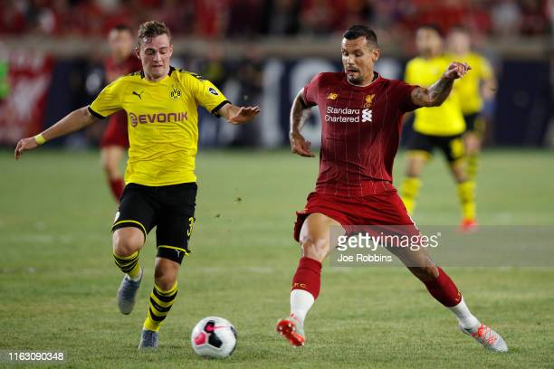 Jacob Bruun Larsen of Borussia Dortmund battles for the ball against Dejan Lovren of Liverpool FC in the second half of the pre-season friendly match...