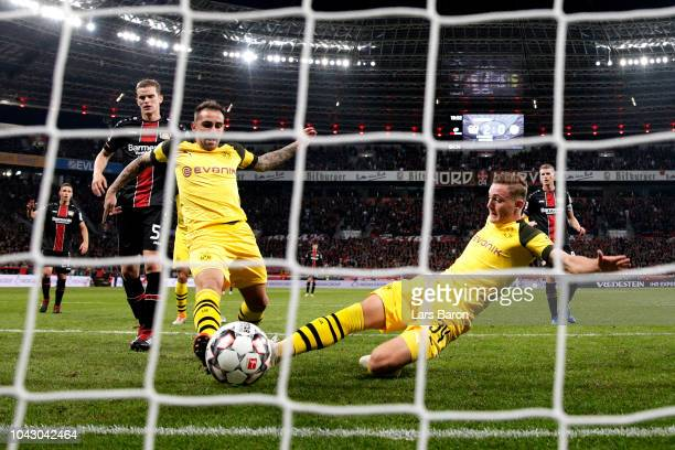 Jacob Bruun Larsen of Borussia Dortmund beats teammate Paco Alcacer to the ball to score his sides opening goal to make the score 21 during the...