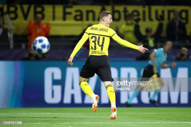 Jacob Bruun Larsen of Borussia Dortmund celebrates after scoring his team's first goal during the Group A match of the UEFA Champions League between...