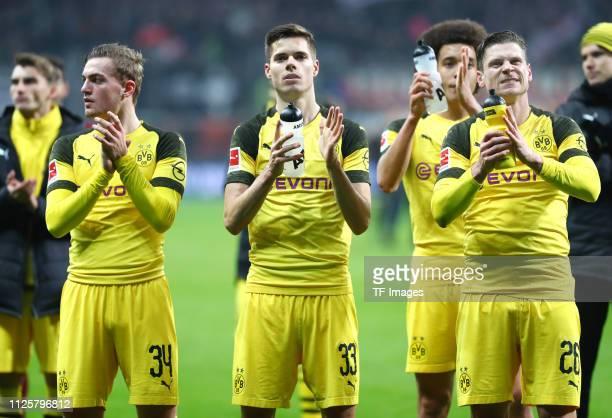 Jacob Bruun Larsen of Borussia Dortmund Julian Weigl of Borussia Dortmund Axel Witsel of Borussia Dortmund and Lukasz Piszczek of Borussia Dortmund...
