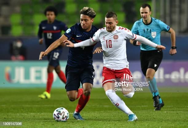 Jacob Bruun Larsen of Denmark battles for possession with Boubacar Kamara of France during the 2021 UEFA European Under-21 Championship Group C match...