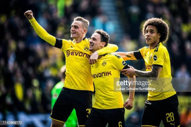 Jacob Bruun Larsen scorer Thomas Delaney and Axel Witsel of Dortmund celeberate their team's second goal during the Bundesliga match between Borussia...