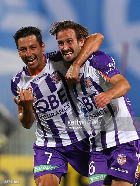 Jacob Burns and Nick Ward of the Glory celebrate scoring a goal during the round 13 ALeague match between the Perth Glory and the Western Sydney...