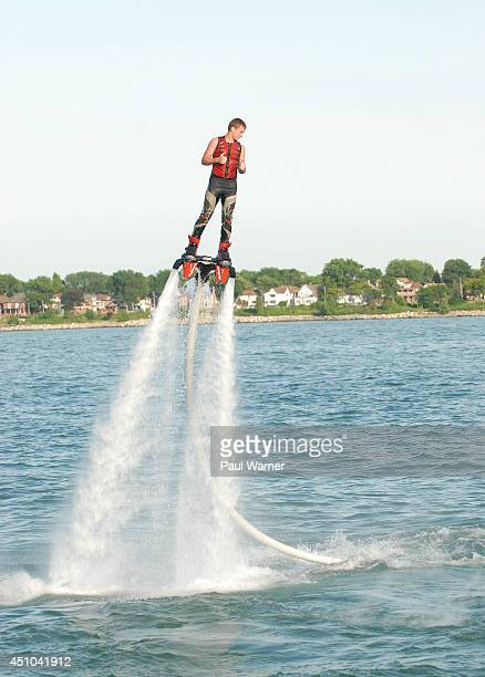 Jacob Burns of Clarkston MI rides a Flyboard during Detroit River Days 2014 at the Detroit Riverfront on June 21 2014 in Detroit Michigan