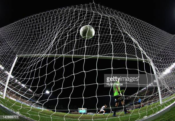 Jacob Burns of the Glory scores the winning penalty during the A-League Grand Final Qualifier match at Bluetongue Stadium on April 14, 2012 in...