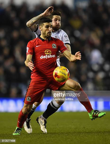 Jacob Butterfield of Derby County battles for the ball with Jordi Gomez of Blackburn Rovers during the Sky Bet Championship match between Derby...