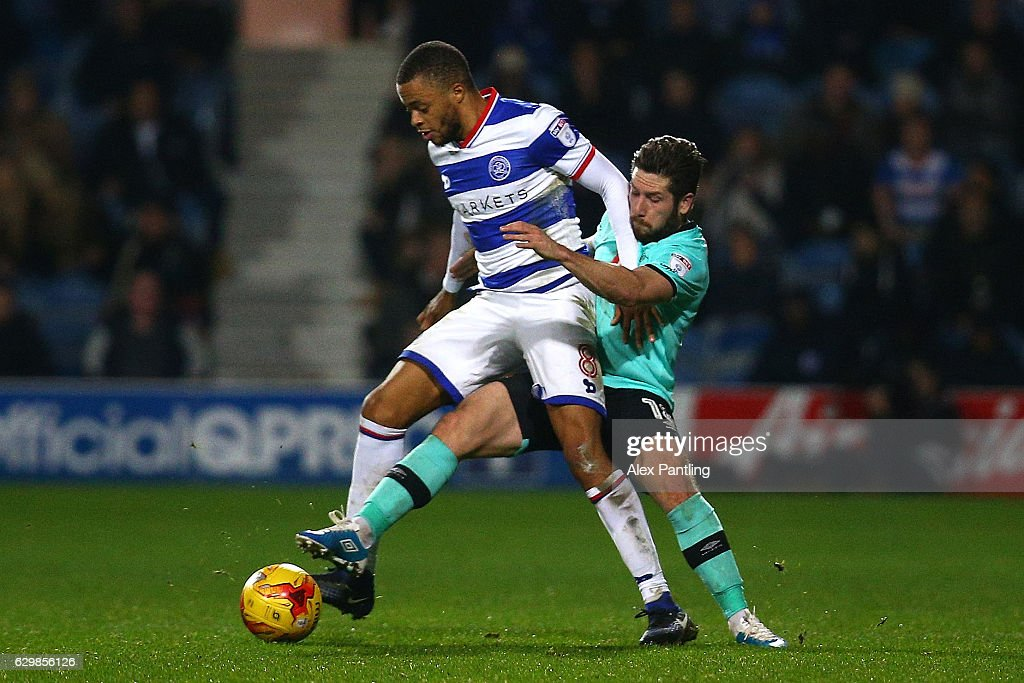 Jacob Butterfield of Derby County challenges Jordan Cousins of QPR during the Sky Bet Championship match between Queens Park Rangers and Derby County at Loftus Road on December 14, 2016 in London, England.