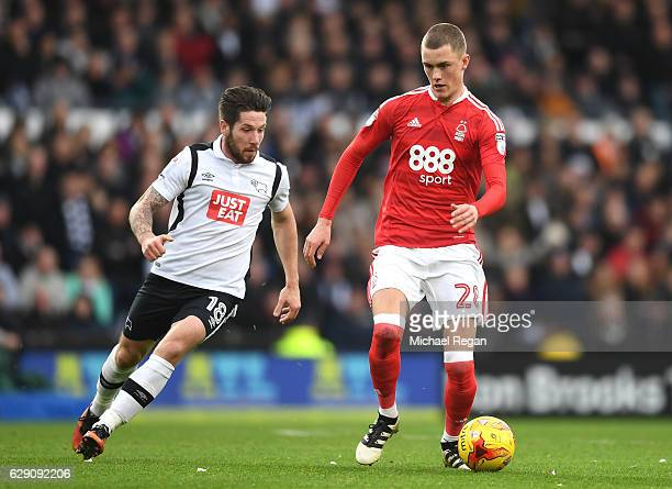 Jacob Butterfield of Derby County closes down Thomas Lam of Nottingham Forest during the Sky Bet Championship match between Derby County and...