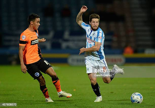 Jacob Butterfield of Huddersfield gets past Adam Chicksen of Brighton during the Sky Bet Championship match between Huddersfield Town and Brighton...