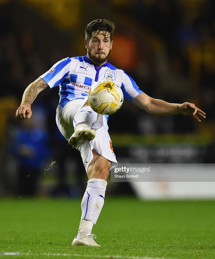 Jacob Butterfield of Huddersfield Town in action during the Sky Bet Championship match between Wolverhampton Wanderers and Huddersfield Town at Molineux on October 1, 2014 in Wolverhampton, England.