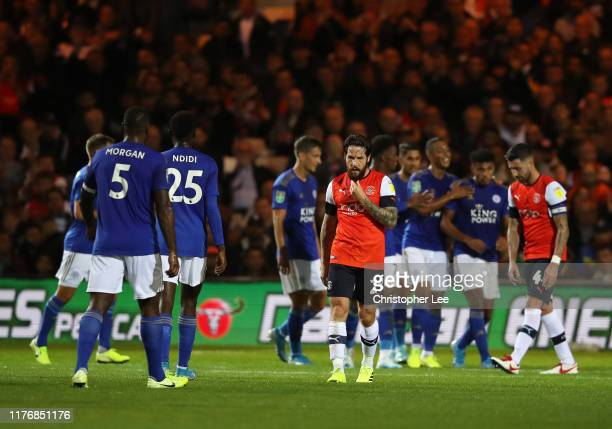 Jacob Butterfield of Luton Town and Ryan Tunnicliffe of Luton Town react as James Justin of Leicester City celebrates after scoring his sides second...