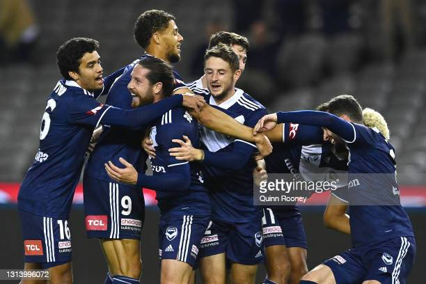 Jacob Butterfield of the Victory is congratulated by team mates after scoring a goal during the A-League match between the Melbourne Victory and the...