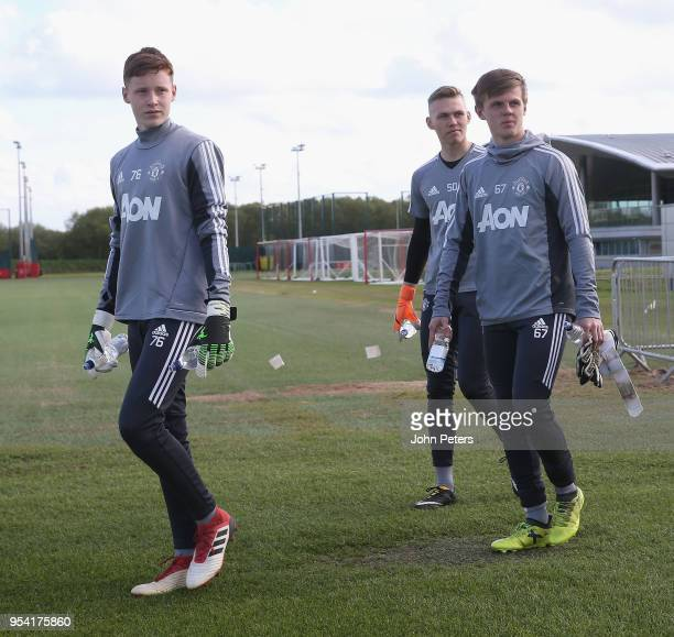 Jacob Carney Alex Fojticek and James Thompson of Manchester United U18s in action during an U18s training session at Aon Training Complex on May 2...