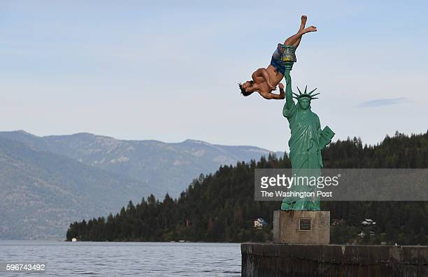 Jacob Clad flips into Lake Pend Oreille from a replica of the Statue of Liberty on Wednesday June 22 2016 in Sandpoint ID Northern Idaho and the...