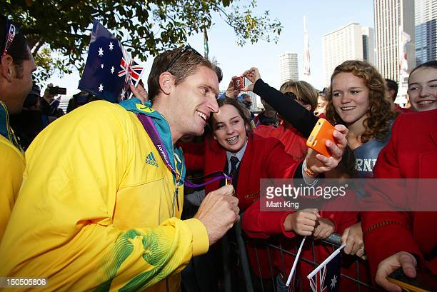 Jacob Clear interacts with the public during the Australian Olympic Team Homecoming Parade in the Sydney CBD on August 20 2012 in Sydney Australia