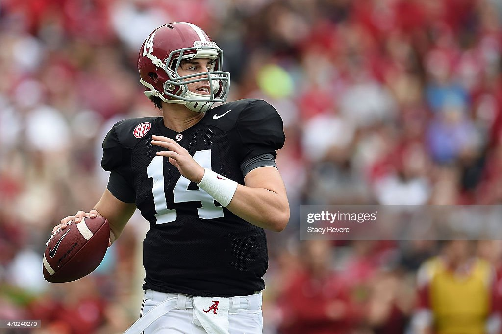 Jacob Coker #14 of the White team drops back to pass against the Crimson team during the University of Alabama A Day spring game at Bryant-Denny Stadium on April 18, 2015 in Tuscaloosa, Alabama.