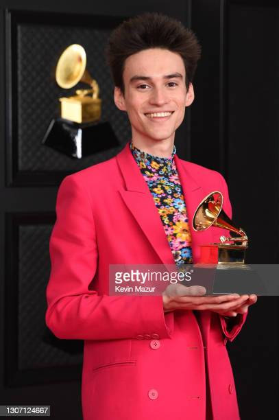 Jacob Collier, winner of the Best Arrangement, Instruments and Vocals award for 'He Won't Hold You,' poses in the media room during the 63rd Annual...