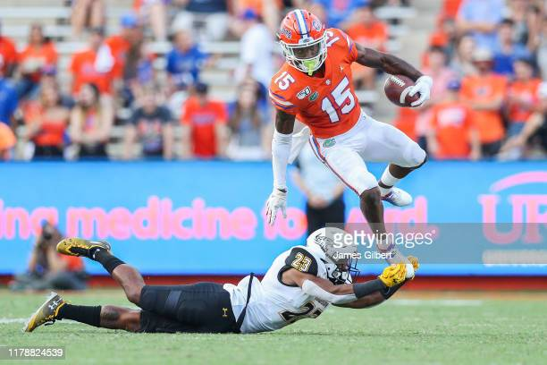 Jacob Copeland of the Florida Gators avoids a tackle by Jirhe Love of the Towson Tigers during the fourth quarter of a game at Ben Hill Griffin...