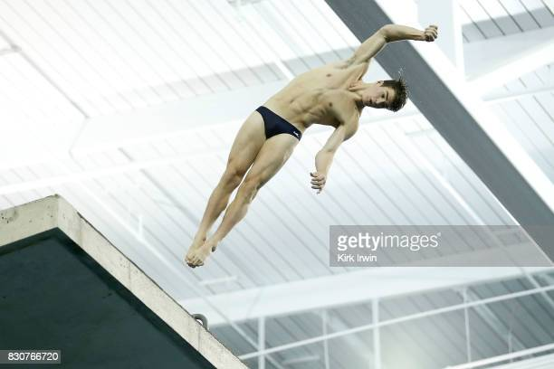 Jacob Cornish of the University of Texas competes during the Senior Men's Platform Final during the 2017 USA Diving Summer National Championships on...