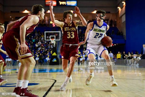 Jacob Cushing of the Delaware Fightin Blue Hens dribbles against Simon Wright of the Elon Phoenix during the first half at the Bob Carpenter Center...