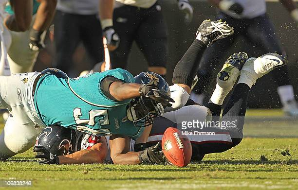 Jacob Cutrera of the Jacksonville Jaguars recovers a fumble from Joel Dreessen during a game against the Houston Texans at EverBank Field on November...