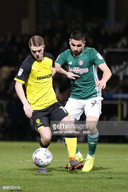 Jacob Davenport of Burton Albion and Neal Maupay of Brentford during the Sky Bet Championship match between Burton Albion and Brentford the at...