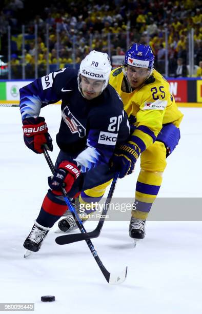 Jacob de la Rosa of Sweden and Chris Kreider of the United States battle for the puck during the 2018 IIHF Ice Hockey World Championship Semi Final...