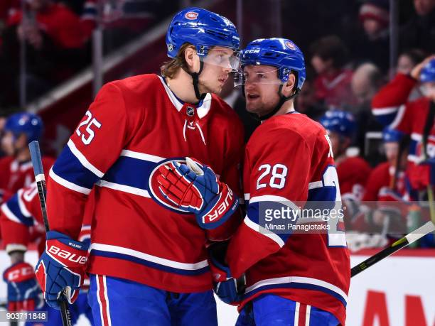 Jacob de la Rose and teammate Jakub Jerabek of the Montreal Canadiens speak with each other against the Vancouver Canucks during the NHL game at the...