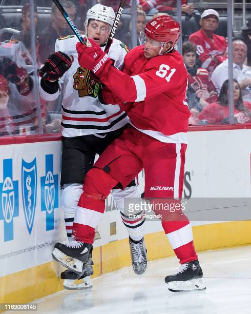 Jacob de la Rose of the Detroit Red Wings checks Connor Murphy of the Chicago Blackhawks during a pre-season NHL game at Little Caesars Arena on...