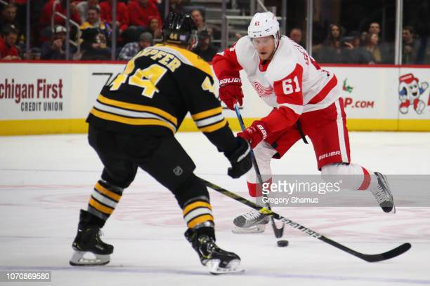 Jacob de la Rose of the Detroit Red Wings looks to get around the defense of Steven Kampfer of the Boston Bruins during the third period at Little...