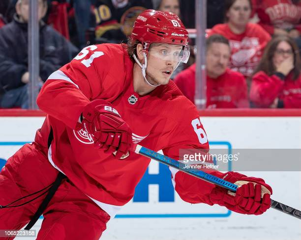 Jacob De La Rose of the Detroit Red Wings passes the puck against the Vancouver Canucks during an NHL game at Little Caesars Arena on November 6 2018...